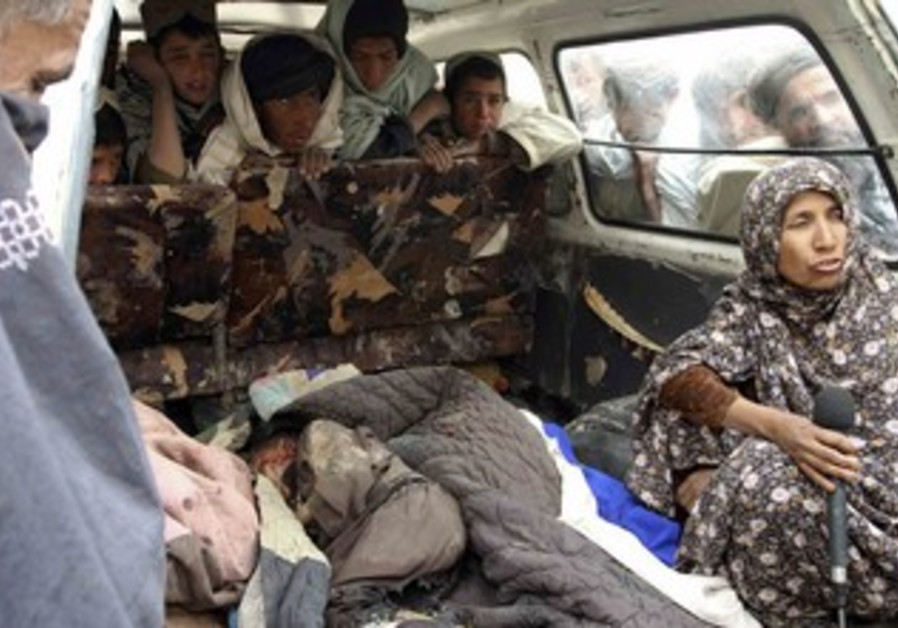 Afghan woman interviewed next to body of killed ch