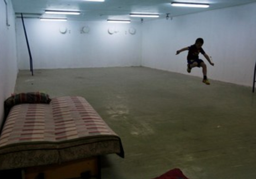 Israeli child in a bomb shelter