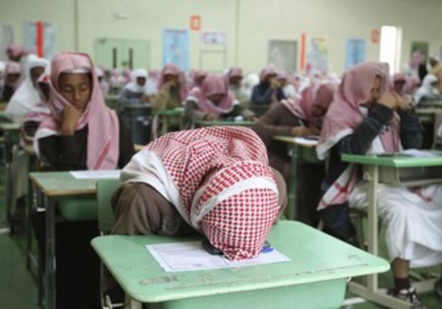 Students sit for an exam in a school in Riyadh