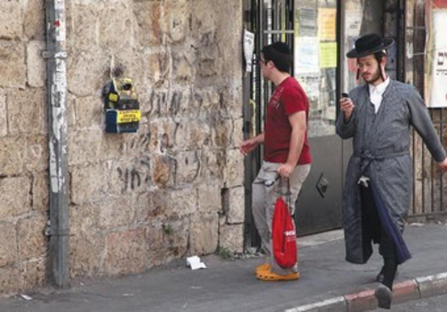Haredi and secular in Mea Shearim