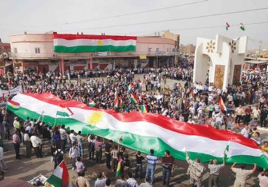 Iraqi Kurds waving flags