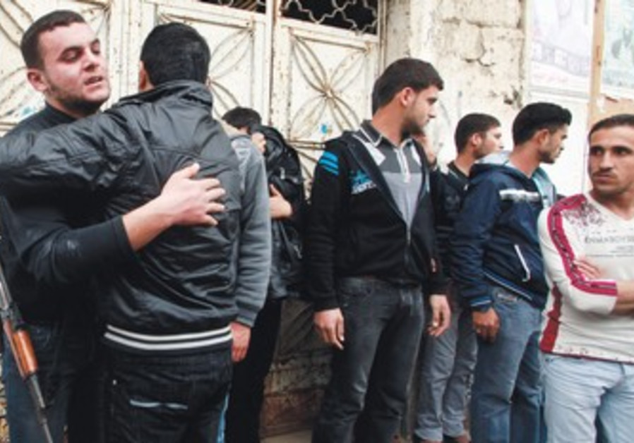 Palestinians after funeral of terrorist