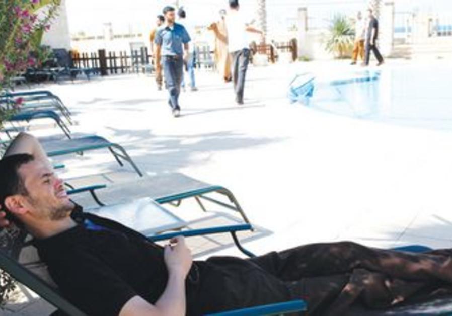 Freed Palestinian prisoner poolside in Gaza [file]