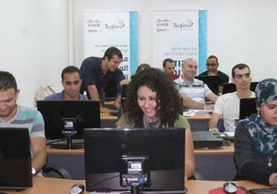 Israelis working at computer desks