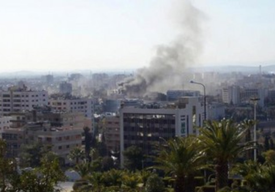 Site of alleged car bomb attacks in Damascus
