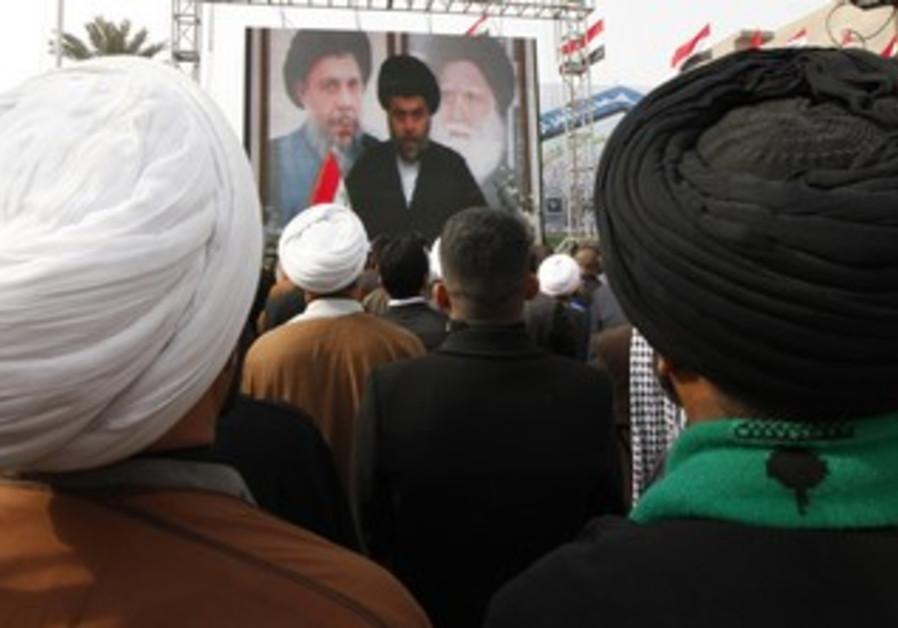 Supporters watch a Moqtada al-Sadr speech [file]