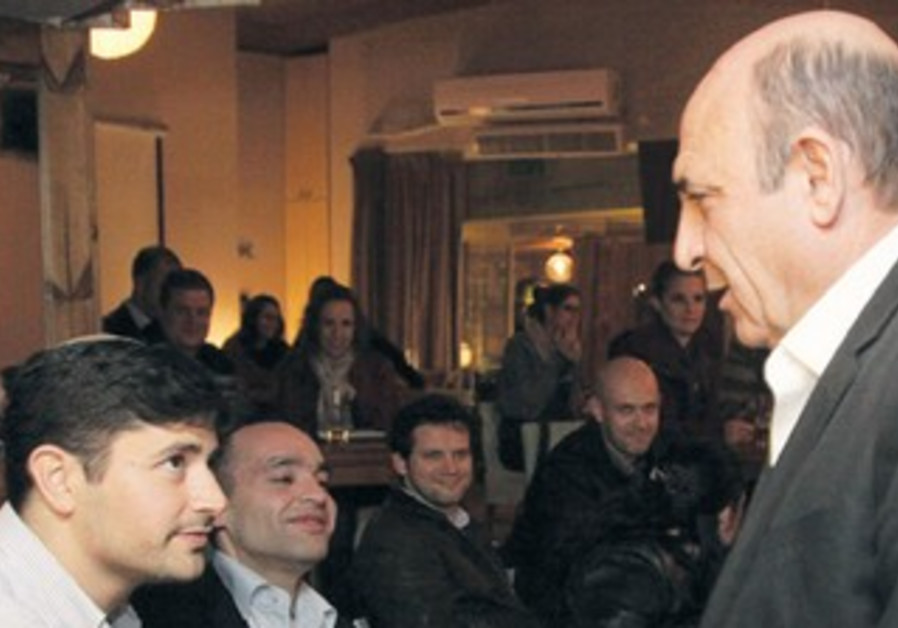 Mofaz shakes hands with supporters