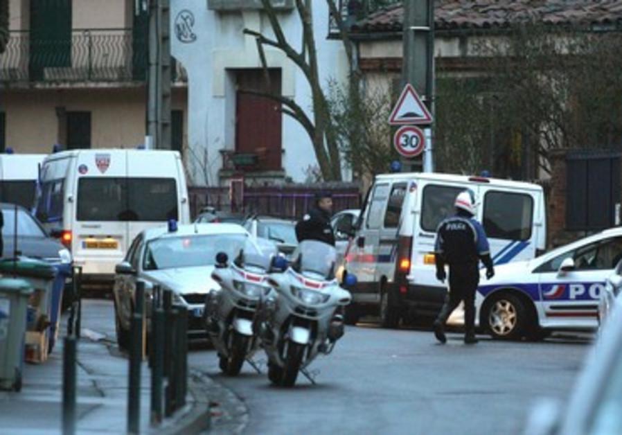 Police at the scene of Toulouse suspect shootout