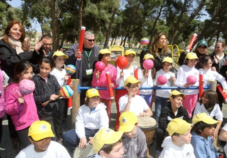 Playing musical instruments with the children