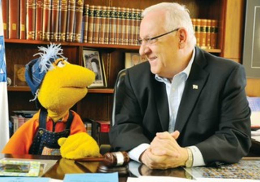 Rivlin welcomes a puppet from TV show Hakuntzonim