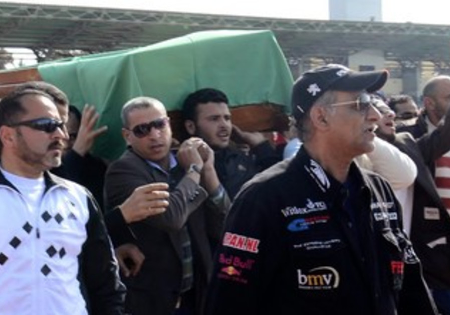 Egyptian protesters carry coffin