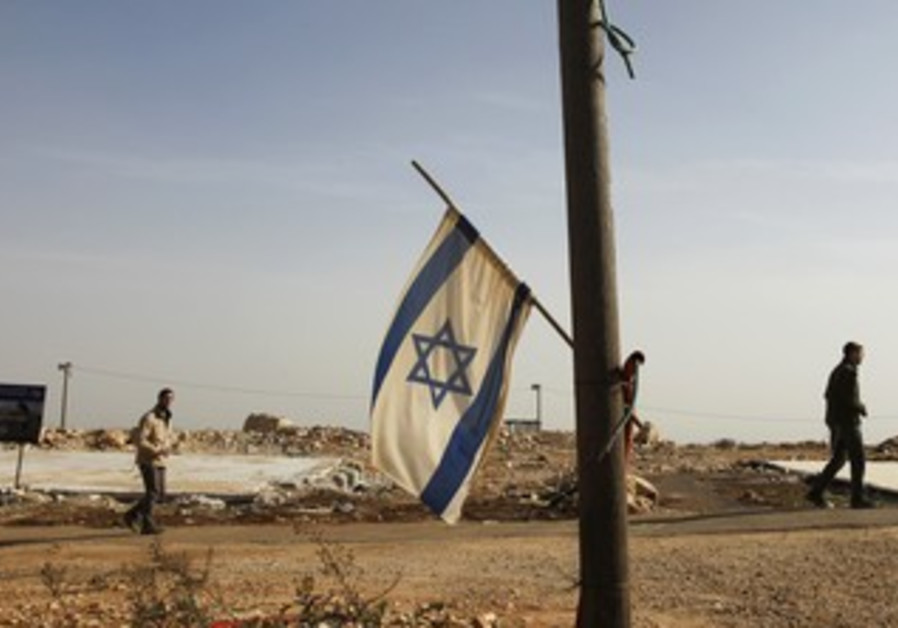 Israeli flag hangs off pole in Migron