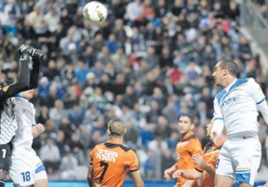 SHIMON ABU HAZEIRA (above right, heading the ball)