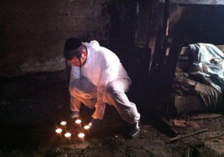 ZAKA volunteer in burned Rehovot house