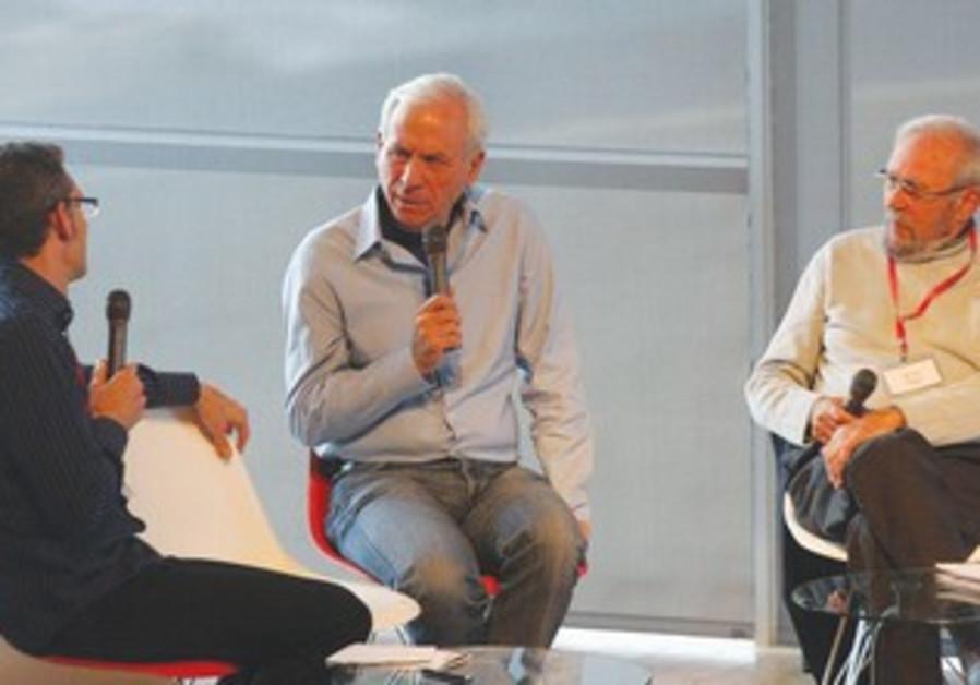 ZOHAR ZISAPEL (center) and Ed Mlavsky (right)