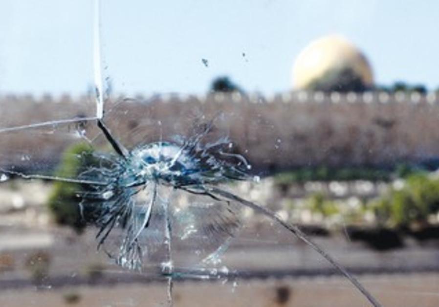 bullet hole in a car windshield in east Jerusalem