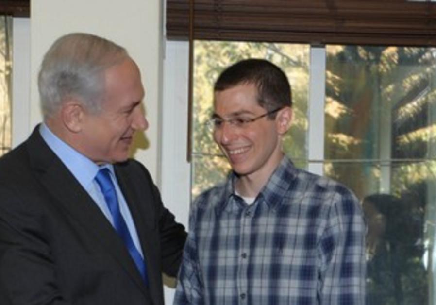 PM Netanyahu and Gilad Schalit in Tel Aviv