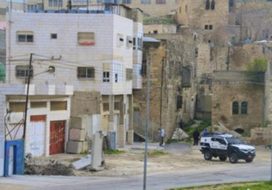 Settlers enter building in Hebron.