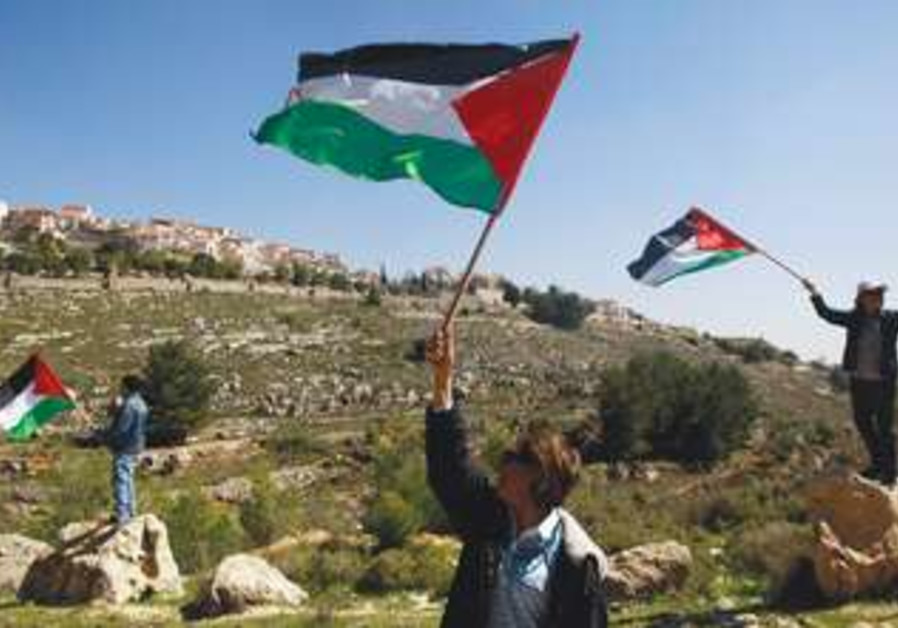 Palestinian flags waving in West Bank