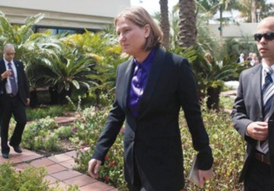 TZIPI LIVNI leaves after casting her ballot