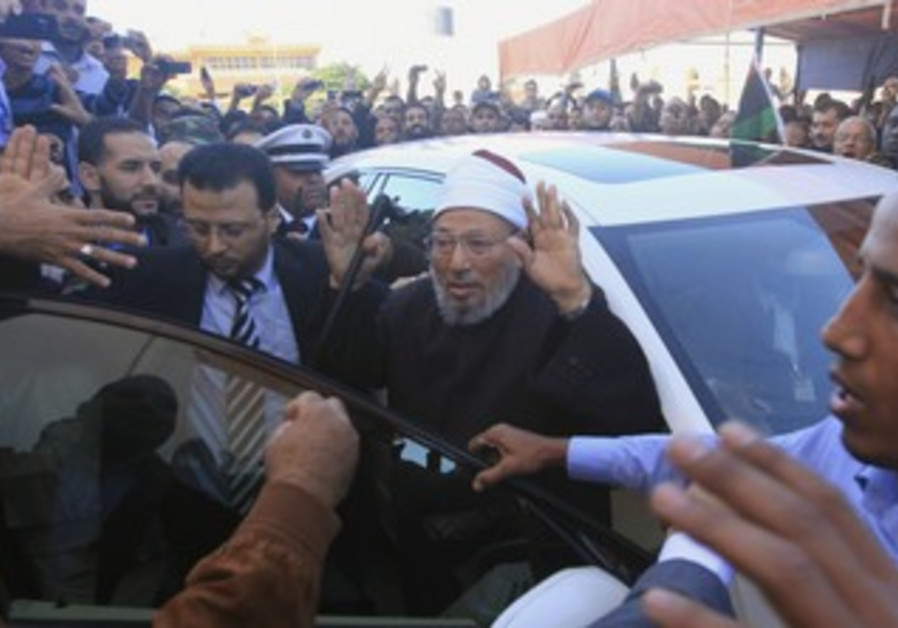 Yusuf Qaradawi arrives for Friday prayers