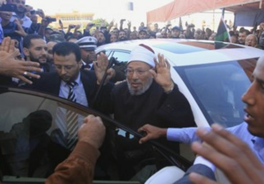 Yusuf Qaradawi arrives for Friday prayers