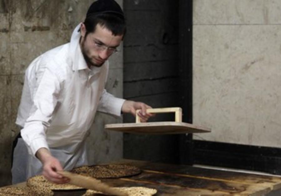 Men in Jerusalem craft handmade matza