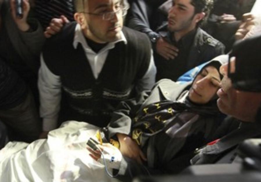 Shalabi is carried to Gaza hospital