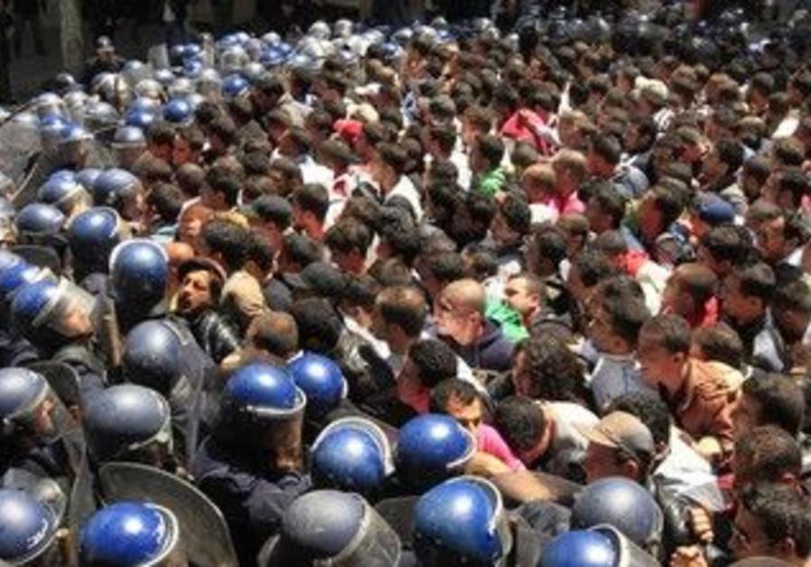 Algerian riot police prevent a 2001 demonstration