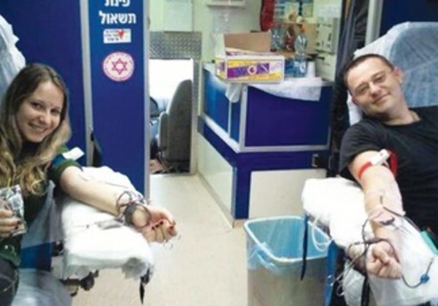 VOLUNTEERS DONATE blood