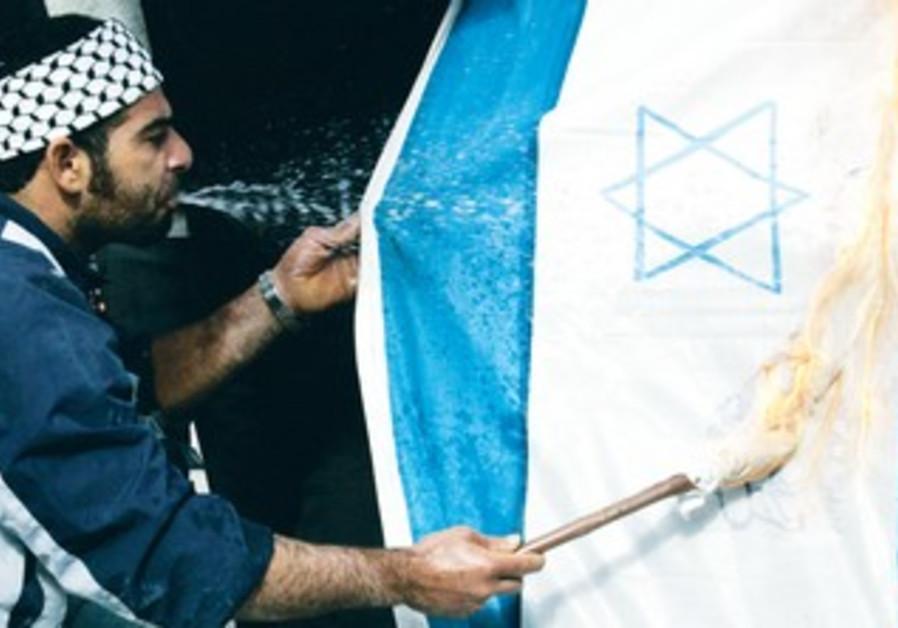 Palestinian man spits gasoline on Israeli flag