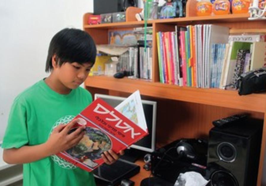 A boy reads in Hebrew