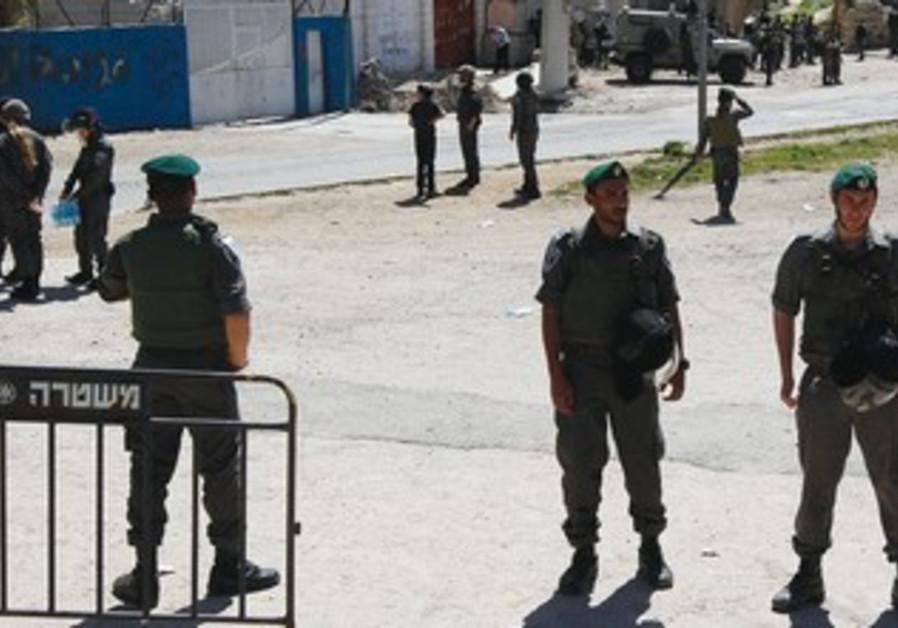 Border policemen at Beith Hamahpelah in Hebron