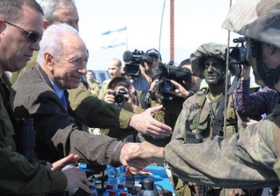 President Peres shakes hands with 7th Brigade sol