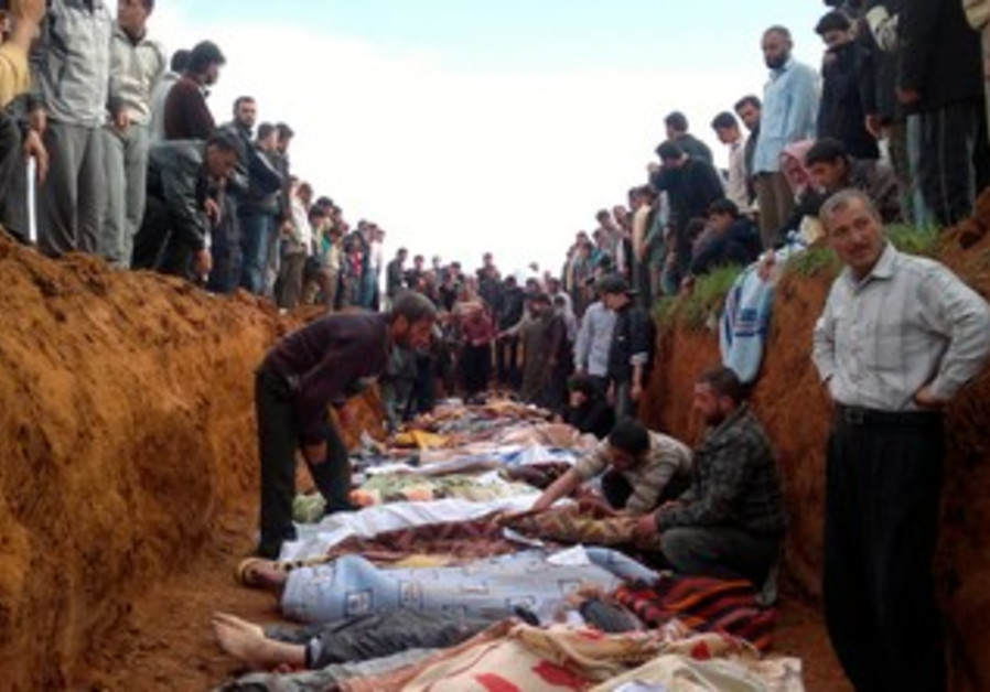 Anti-Assad Syrians bury dead