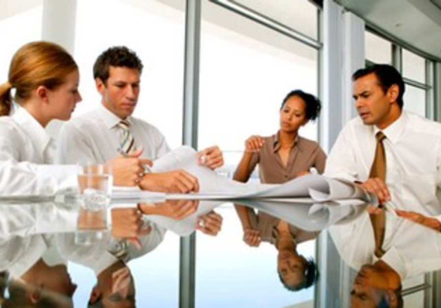 Men and women at a meeting [illustrative photo]