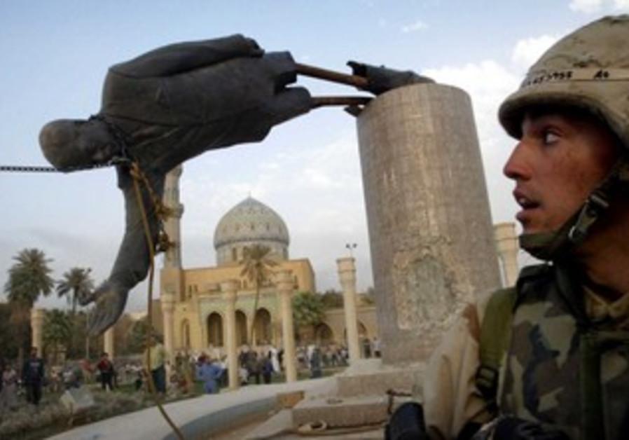 US marine watches as Saddam Hussein statue falls