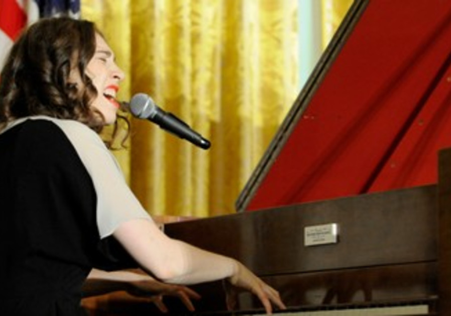 Regina Spektor sings at a reception