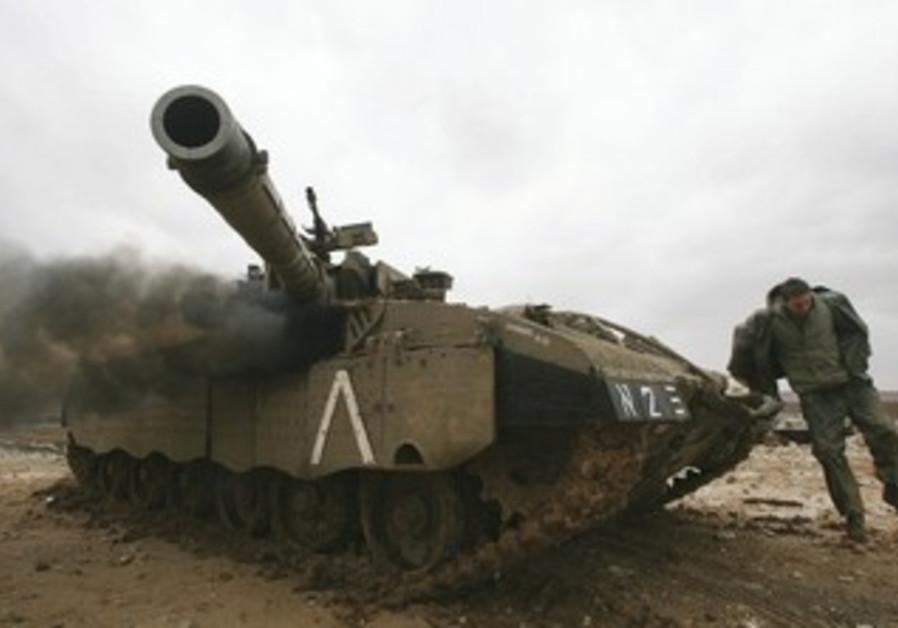 IDF soldier, tank outside northern Gaza