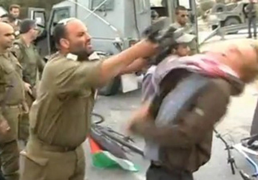 IDF officer hitting activist with M-16