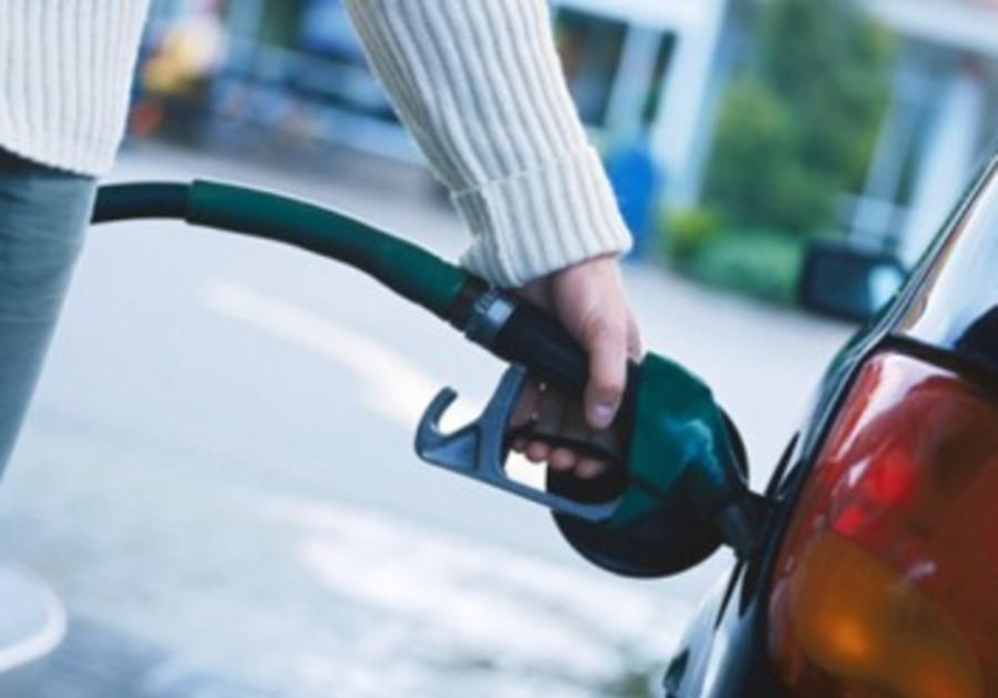 Person filling car gas tank [illustrative]