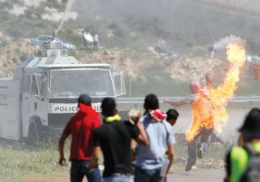 Stone-throwing Palestinian