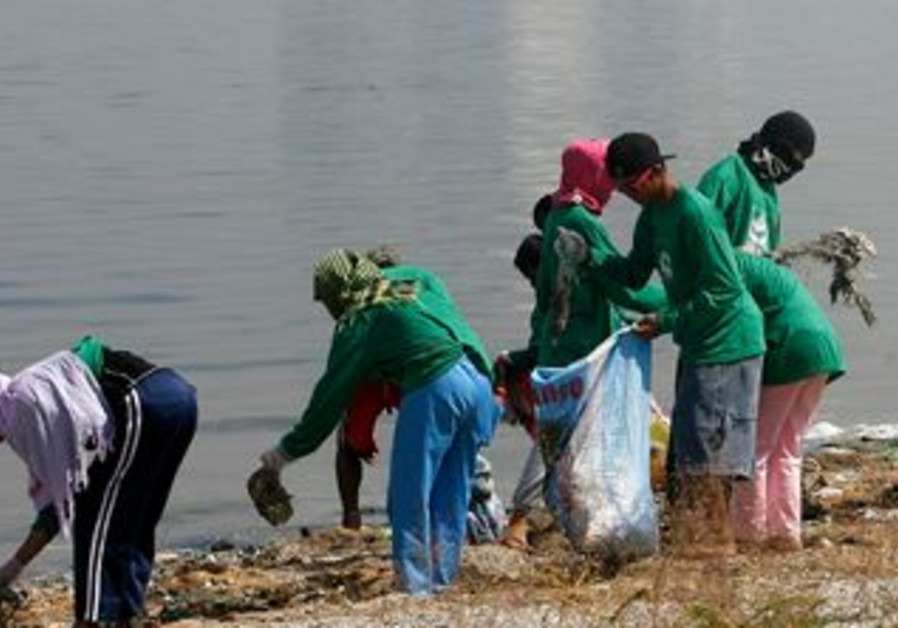 Volunteers collect waste materials in Philippines.