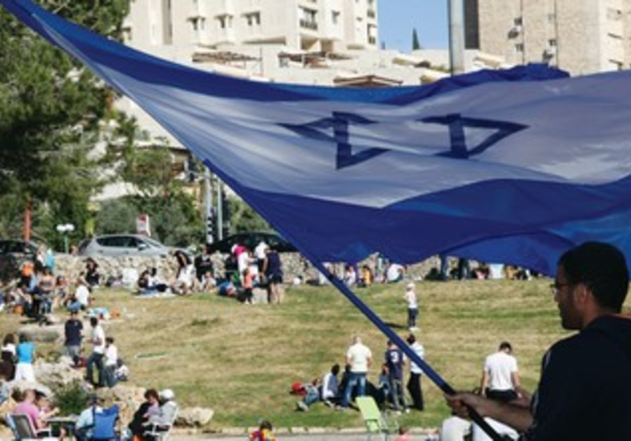Man waves Israeli flag in Jerusalem