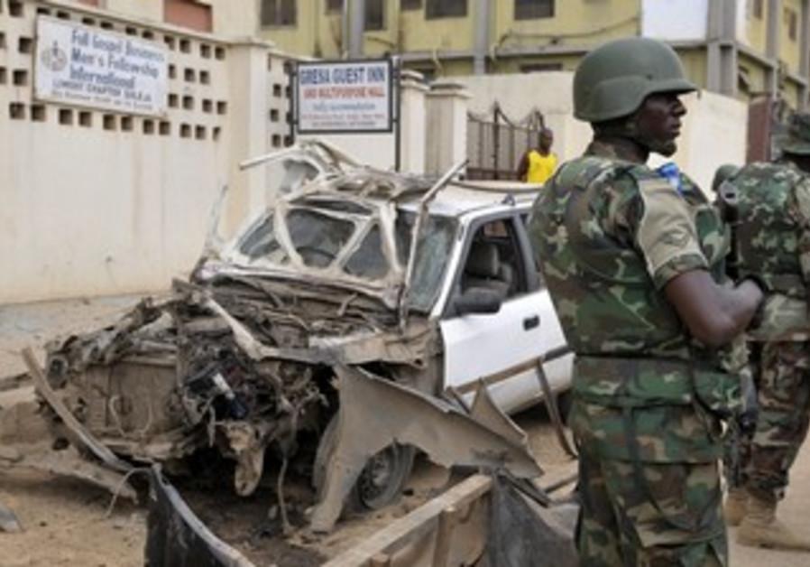 Nigerian soldiers at bomb site near Abuja