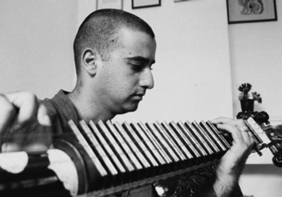 Indian man playing instrument