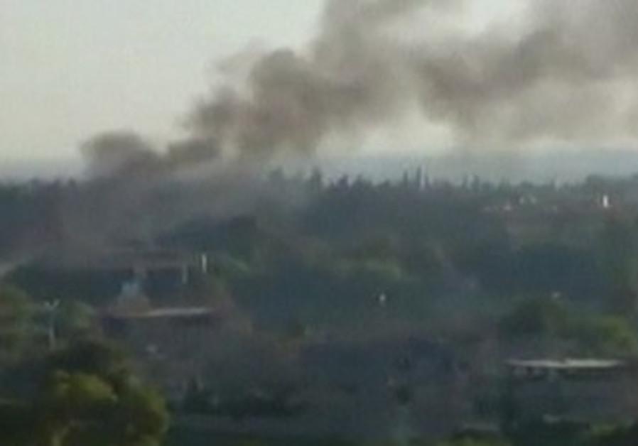 smoke rises in the city of Deir al-Zor [file]