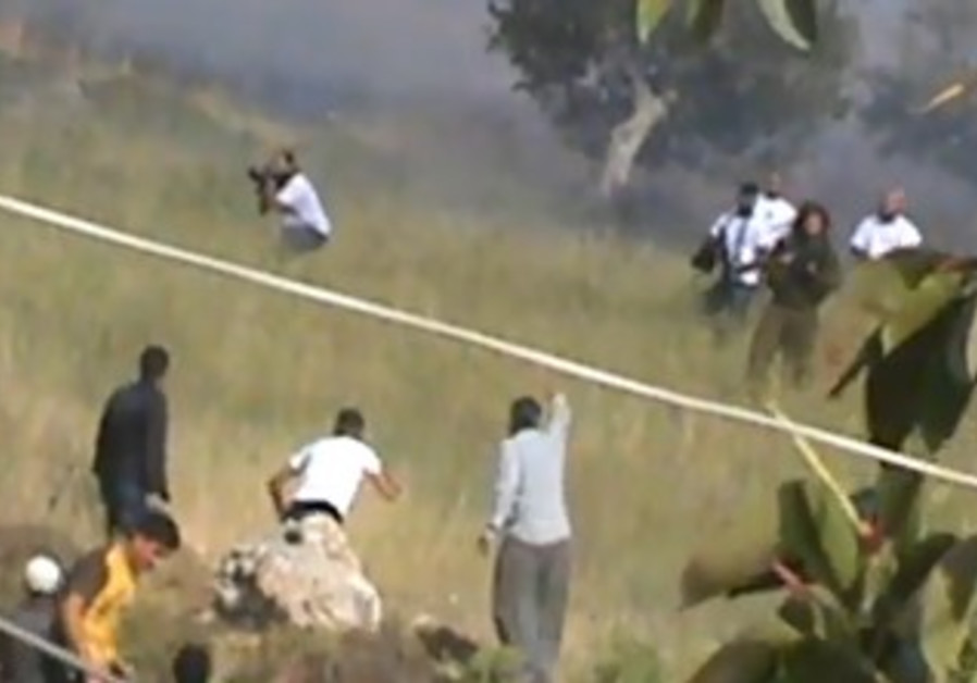 Screenshot of settler, Palestinian clash