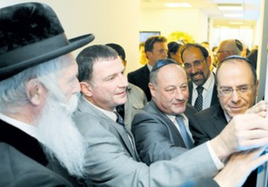 Officials fix mezuza for new office