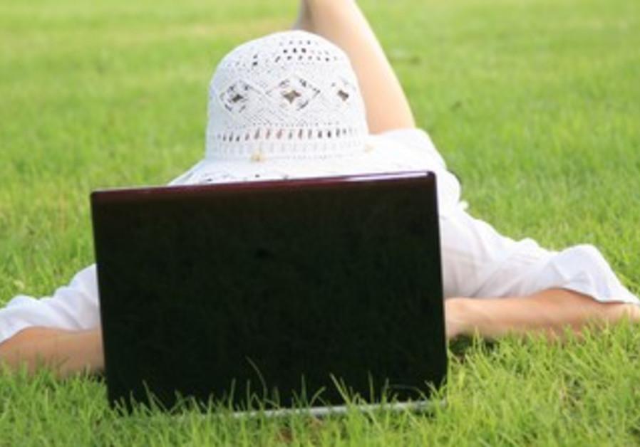 Girl using laptop (illustrative)